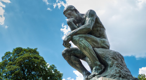 (picture of Auguste Rodin's sculpture, The Thinker)
